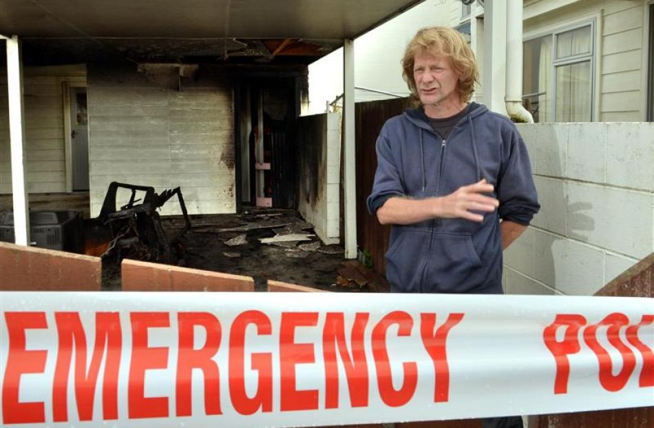 Leith St resident Nick Maydon was woken up by passers-by telling him the carport at his Housing...