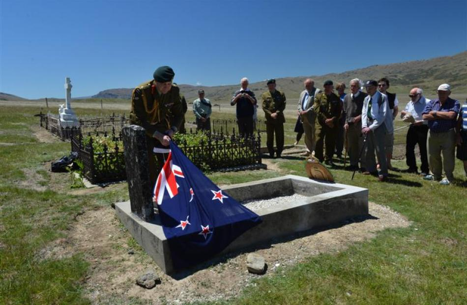 Lieutenant-general Rhys Jones unveils a plaque on the grave of Charles Risk, a World War 1...