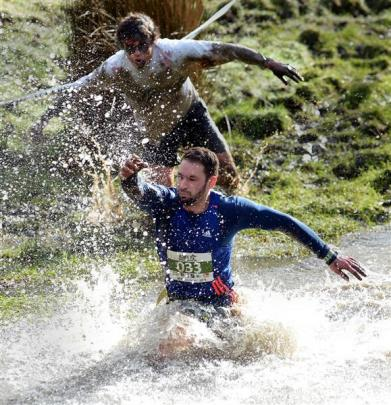 Live human Rob Boyd, of Dunedin, is chased by zombie Nick Williamson, of Dunedin, during the...