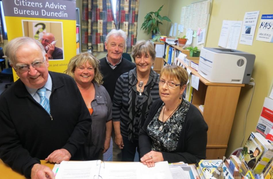 Long-serving Dunedin Citizens Advice Bureau Consumer Team leader Noel Angus (left), who is...
