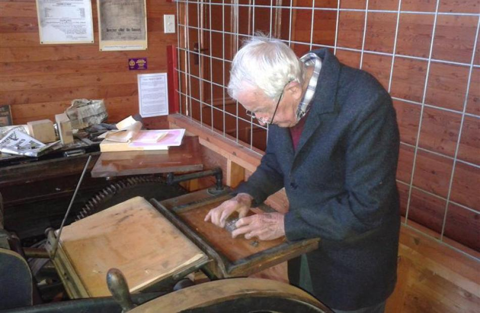 Lou Young, from the  Ferrymead Printing Society, Christchurch, locks the type for the first print...