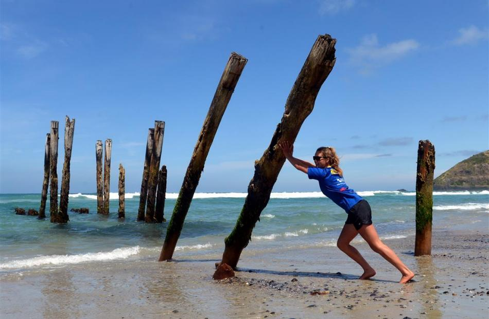 Lucy Matehaere with the St Clair piles  yesterday. Photo by Stephen Jaquiery.