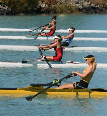 Lucy Strack (North End), in lane four in red and black,  in action in the women's open...