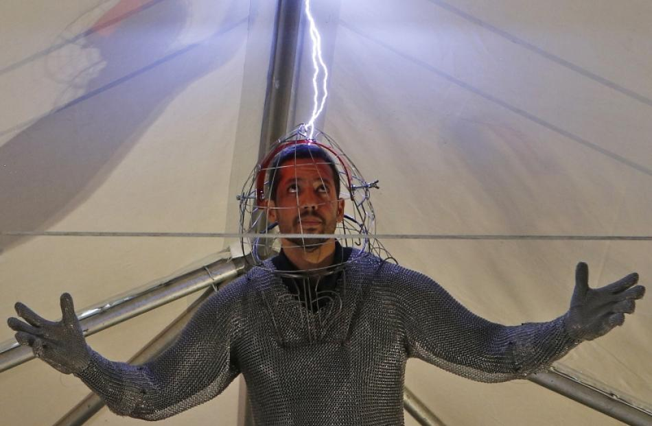"Magician David Blaine performs a demonstration of his upcoming performance ""Electrified"" during a..."