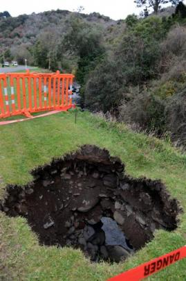Malvern St, Woodhaugh, residents are sick of waiting for sinkholes caused by an eroding stream...