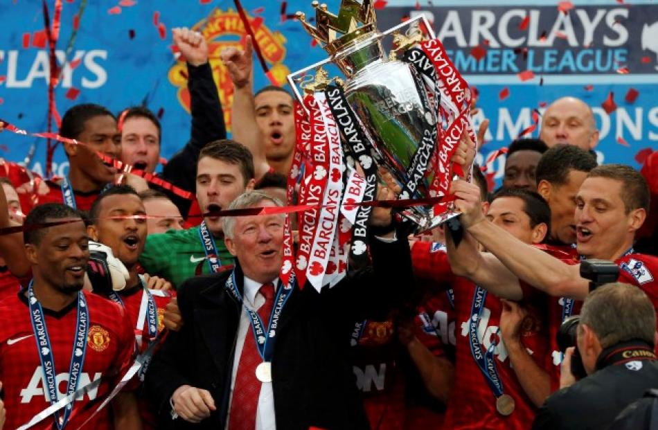 Manchester United Manager Alex Ferguson C Lifts The English Premier League Trophy Surrounded By