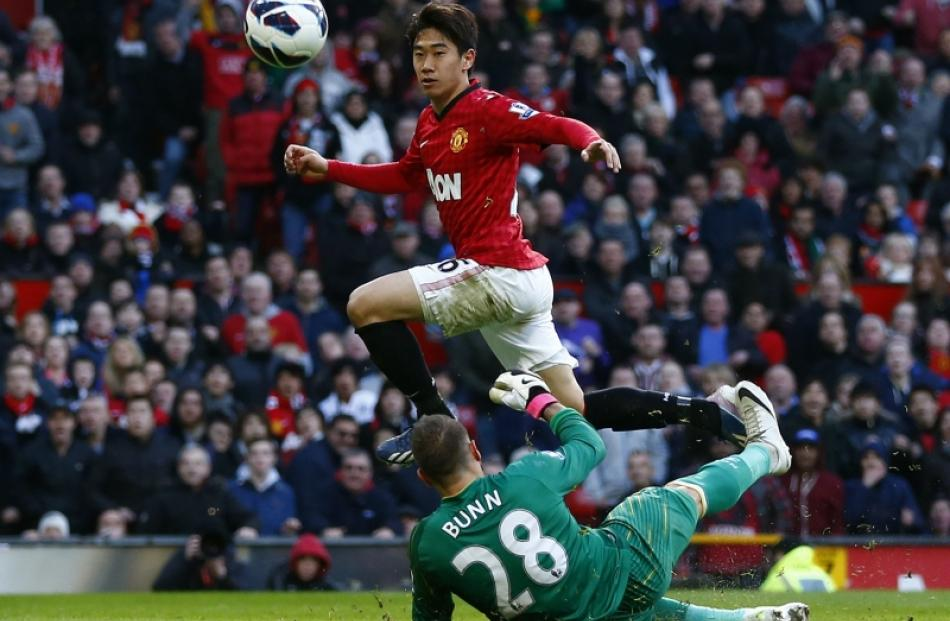 d8c89a854 Manchester United s Shinji Kagawa (left) scores his third goal past Norwich  City s Mark Bunn