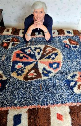 Margaret Woodhead, of Dunedin, with a rug made in the Shetland Islands by her great great...