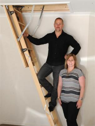 Mark and Hayley McHutchon from Otago Skylights and Heating demonstrate the use of attic stairs at...