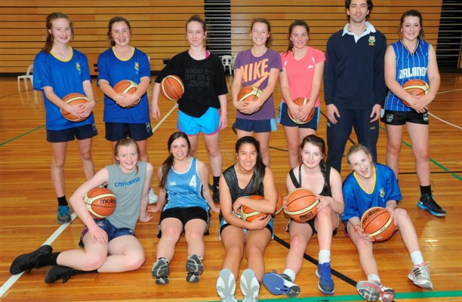 Mark Dickel with some of the rising stars of Otago basketball yesterday. Back, from left: Laura...