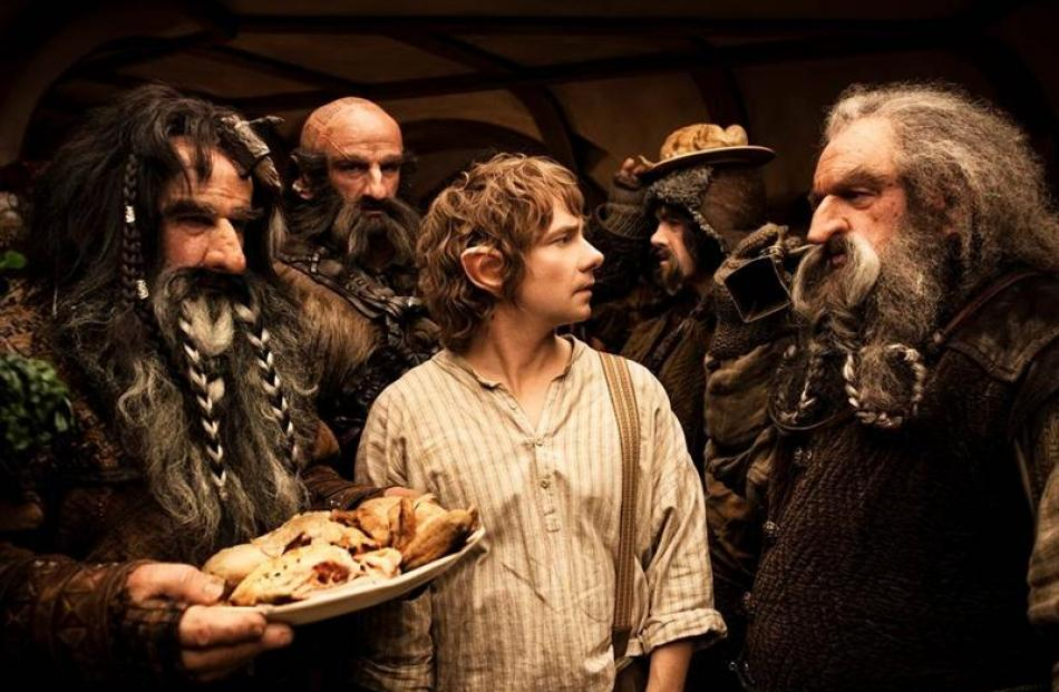 Martin Freeman (centre) stars as Bilbo Baggins in The Hobbit: An Unexpected Journey, which is...
