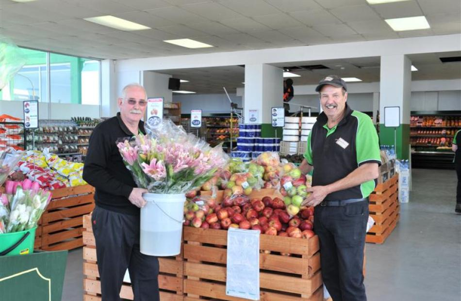 Marty Hay (left) and Barry Gazeley at work at Veggie Boys' new South Dunedin store, which opened...