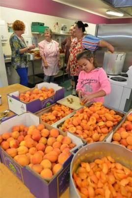 Maruia Vaitupu-Bachop (10), of Normanby, prepares hundreds of Central Otago apricots for jam and...