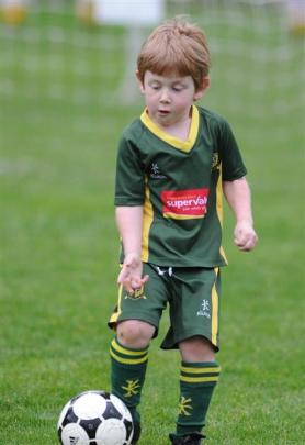 Matthew Barrett (5) shows his ball-dribbling skills for the Green Island Wildcats. Photos by...