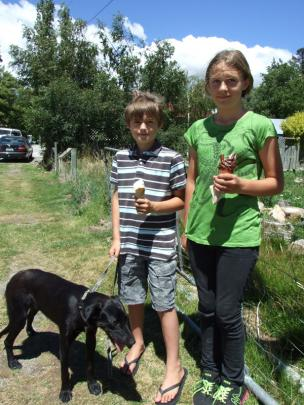 Max (9) and Lucy (11) Lorimer, of Ophir, with their pet Pepper.