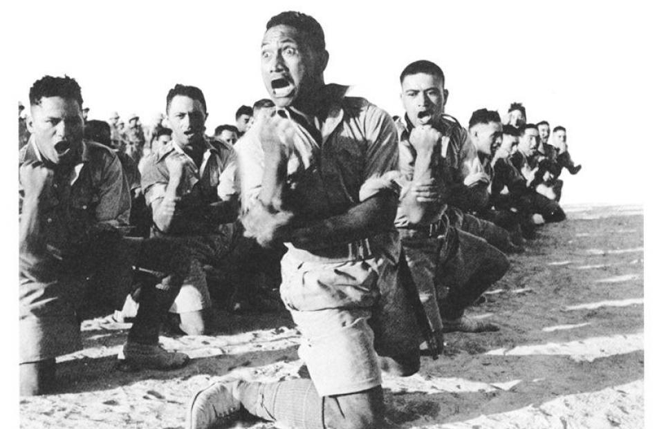 Members of the Maori Battalion perform a haka in the Western Desert in World War 2.
