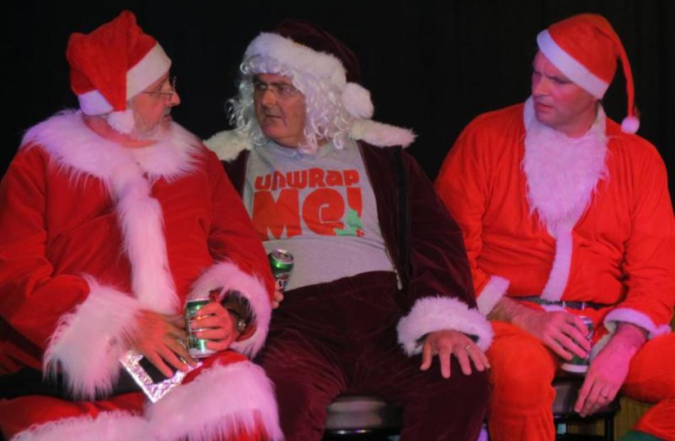 Mich Hewitt, Chris MacKenzie and Andrew Edgar, who also directed, are  Santas Three in the Pint...