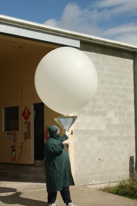 Mike Bailey prepares to launch a balloon.