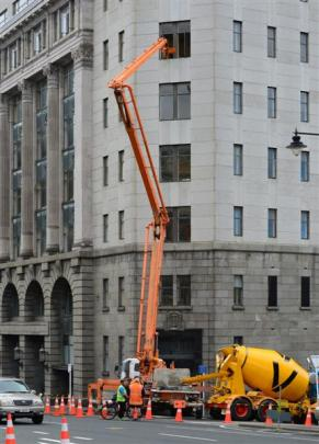 Mixers feeding concrete to the fifth floor of the historic building. Photos by ODT.