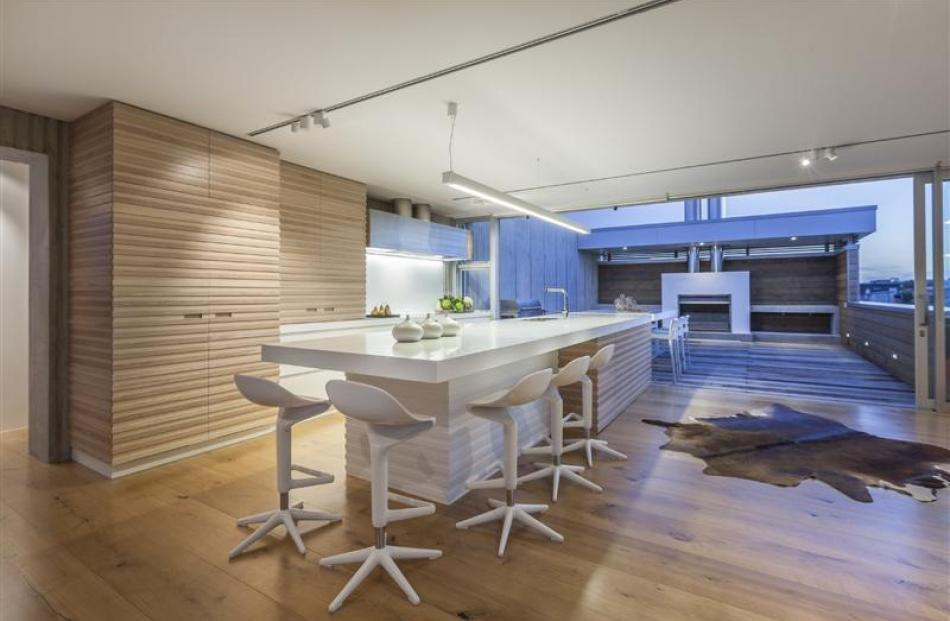 Morgan Cronin used similar materials inside and out to create a cohesive transition between two...