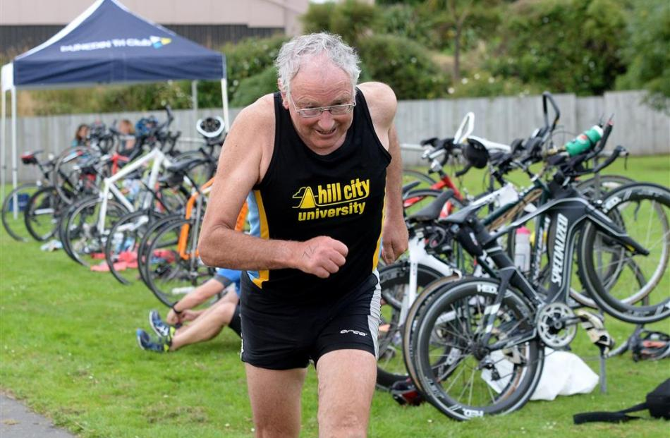 Morris Hall competes in the Masters Games triathlon at Macandrew Bay yesterday. Photo by Linda...