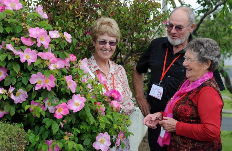 Mosgiel  garden host Ann Williams (right) shows South Australian couple Sue and John Zwar her...