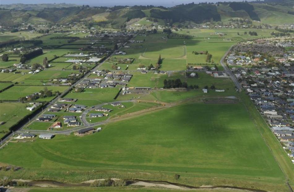 Mosgiel is steadily expanding.  This photograph showing the Silver Springs subdivision was taken...