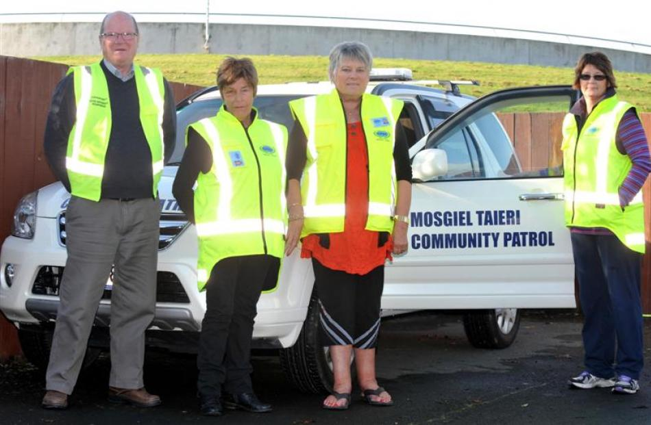 Mosgiel Taieri Community Patrol's new vehicle with volunteers (from left) Bill Feather, Elaine...