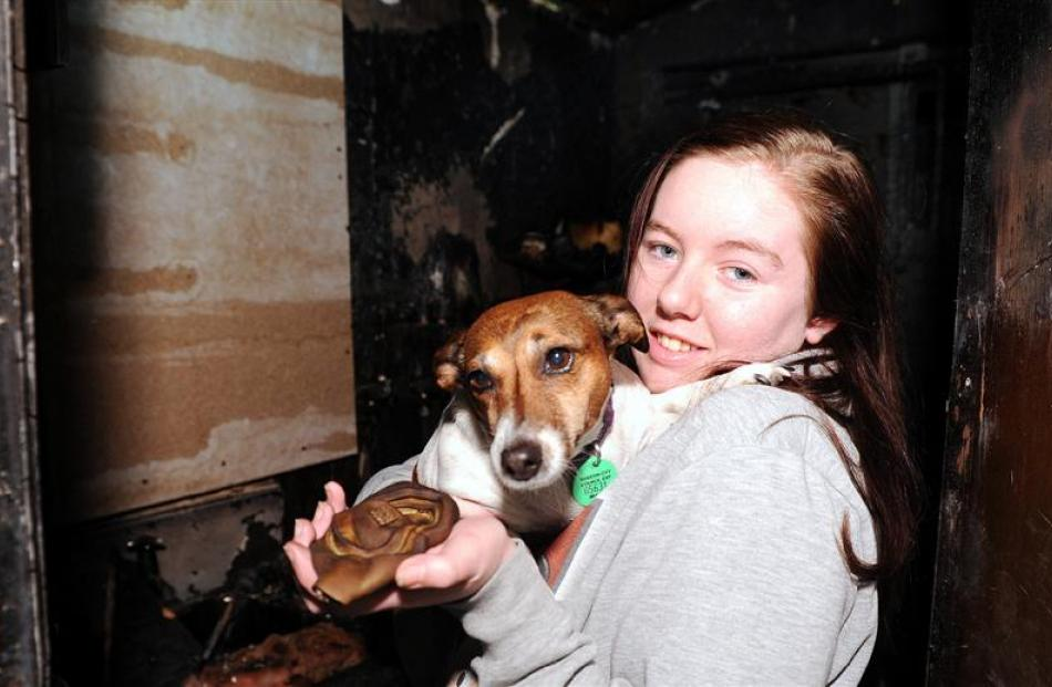 Mosgiel teen Katie O'Brien with her family's miniature Jack Russell, Jewels, and a melted smoke...