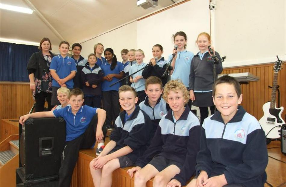 Most of the 27 Queenstown Primary School pupils involved with the school's three rock bands. ...
