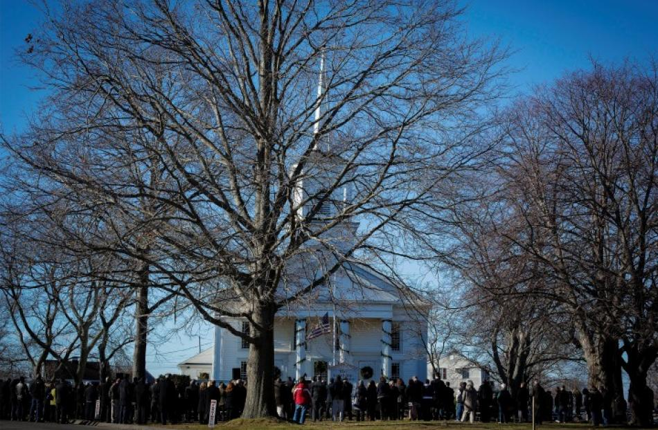 Mourners attend the funeral service of teacher Victoria Soto, a victim of the Sandy Hook...