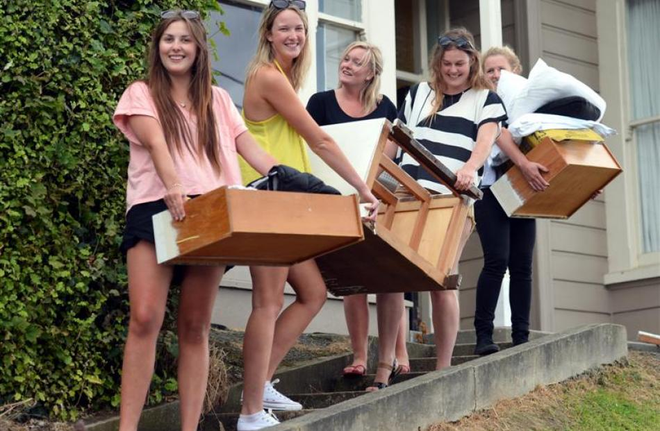 Moving stored items from last year's flat on Dundas St are University of Otago students (from...