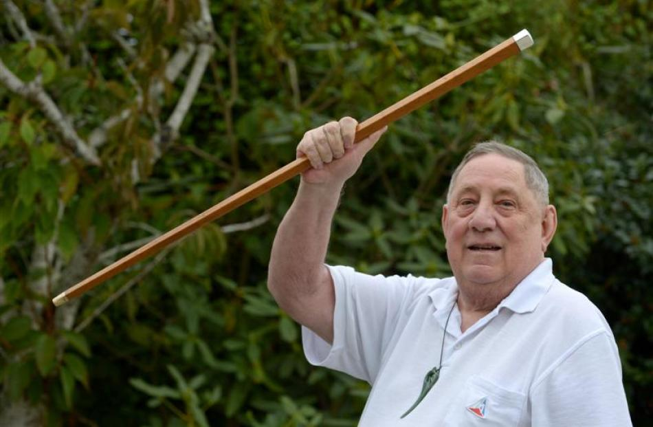 Mr Ellison with the royal cane presented to his grandfather, as featured in the Otago Daily Times...