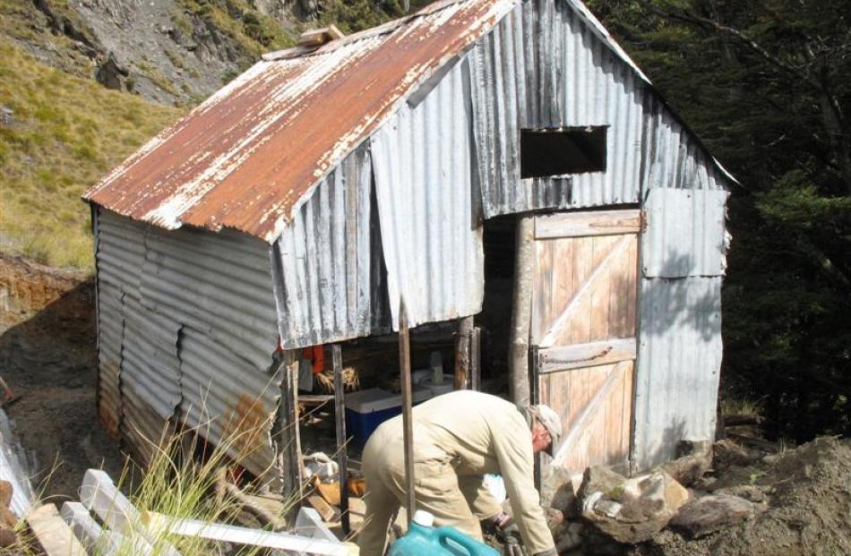 Mr Murfin (left) prepares to start six days of restoration on Wallers hut. Photo by Stew Hardie.