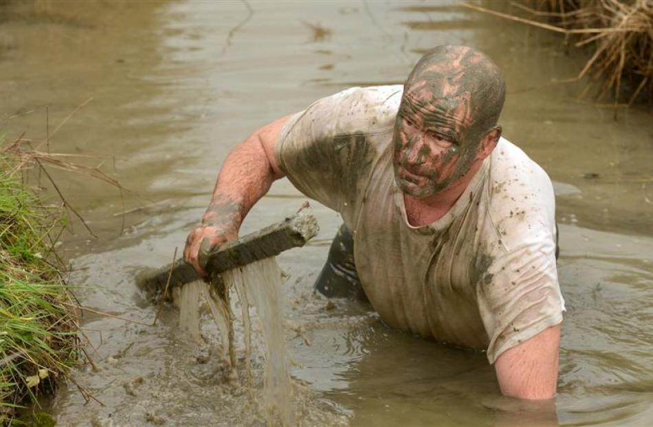 Mud, Sweat and Tears Challenge organiser Russell Lundy gets a taste of the course at Wingatui, as...