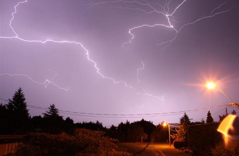 Multiple strikes of lightning illuminate the sky above Omarama on Wednesday.  Photo by Andrew Sise.