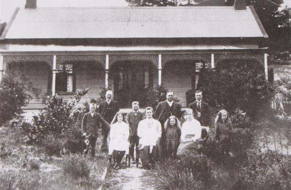 n early photo of the Brown family outside their cottage on Lower Shotover Rd.  The man second...
