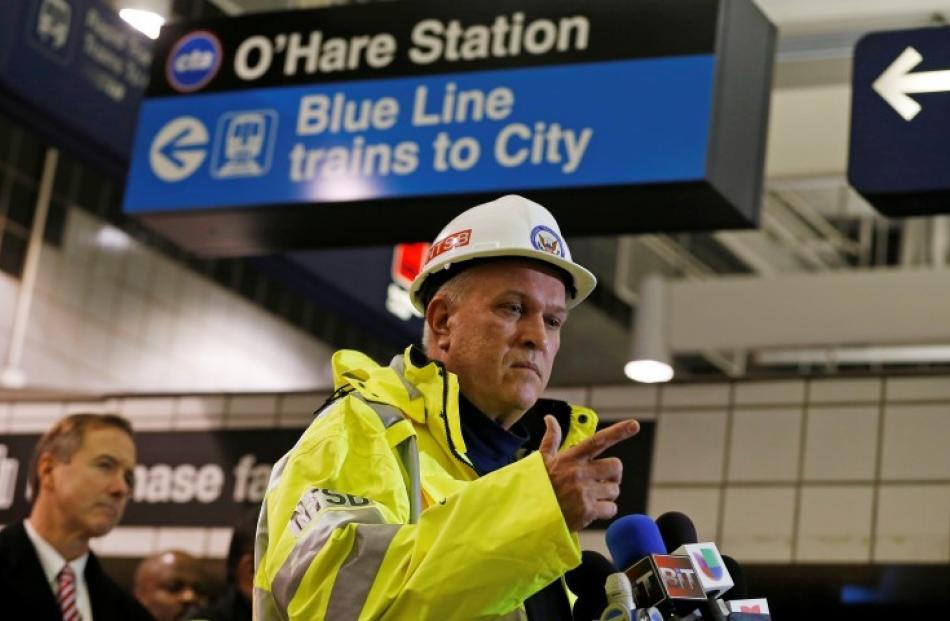 National Transportation Safety Board Railroad Accident Investigator Tim DePaepe speaks at a press...