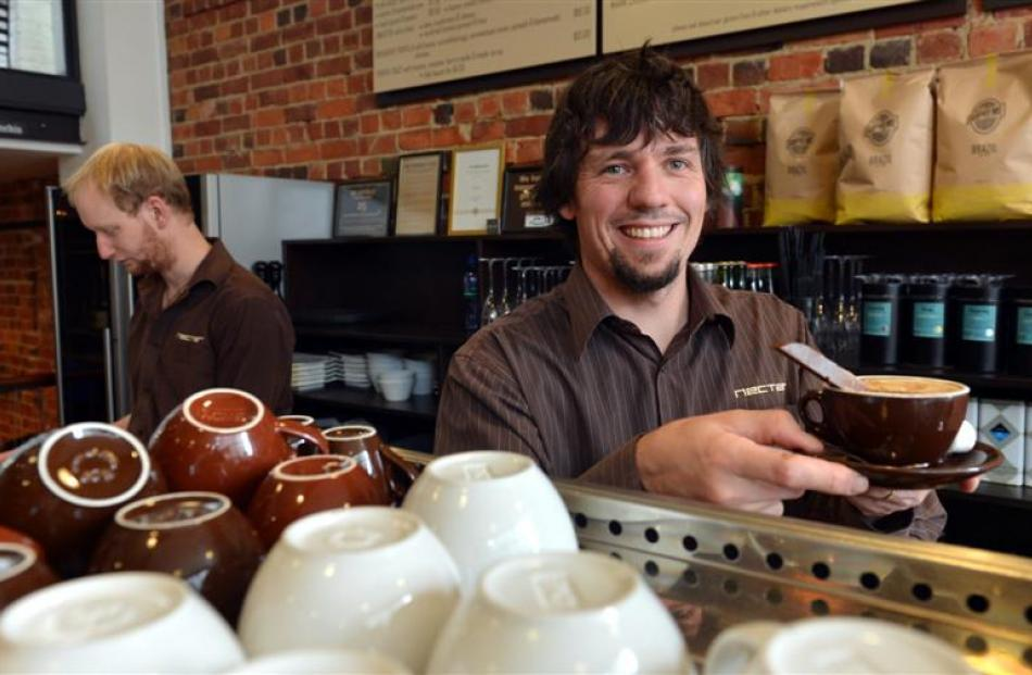 Nectar owner Steven Calvert (right) and Joshua Denniston rush to keep up with increased coffee...