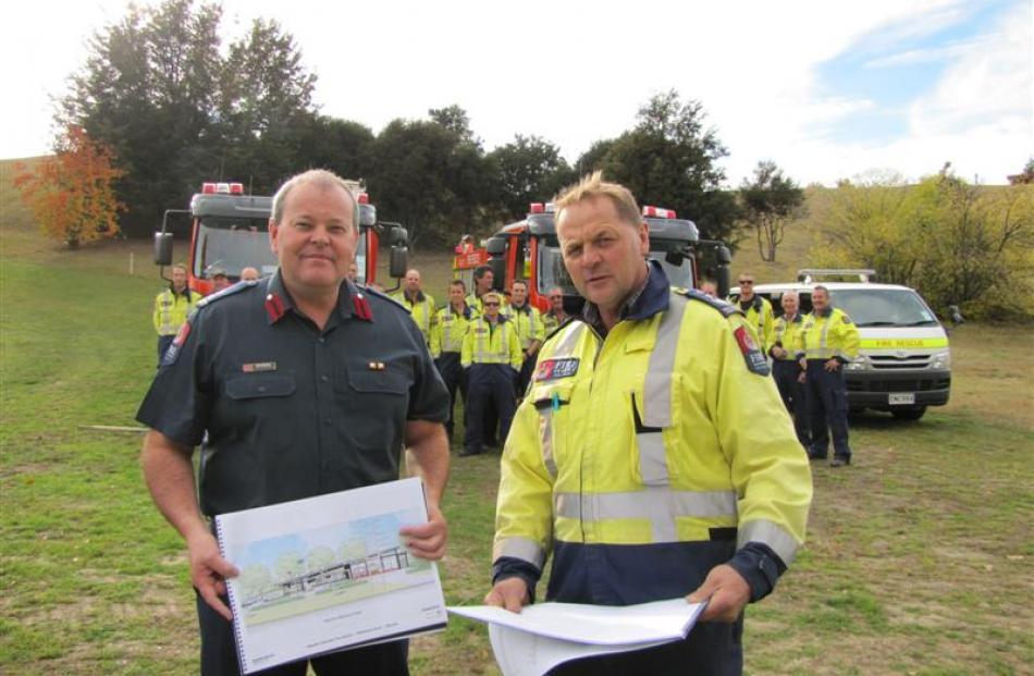New Zealand Fire Service National Commander Paul Baxter (left), Wanaka Volunteer Fire Brigade...