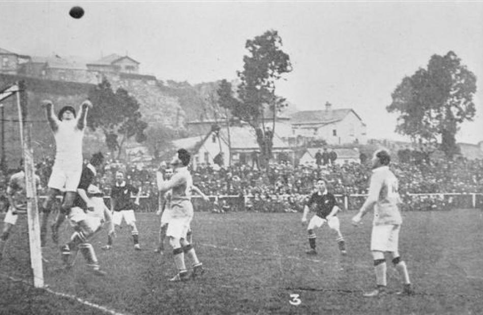 New Zealand (in black jerseys) and Australia play the inaugural football test at Carisbrook in...