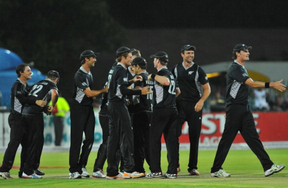 New Zealand players celebrate the series victory over South Africa after winning the second one...