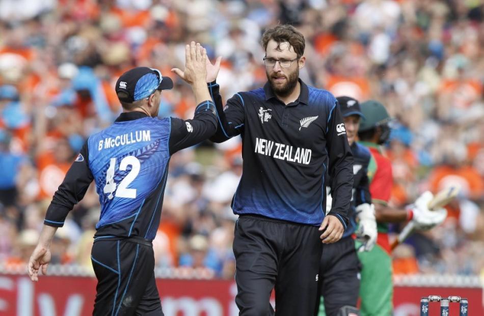 New Zealand's Daniel Vettori (R) celebrates dismissing Bangladesh's Soumya Sarkar with Brendan...