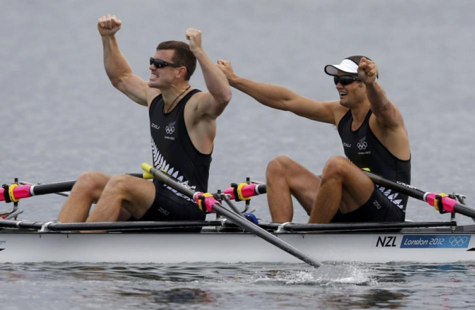 New Zealand's Nathan Cohen and Joseph Sullivan celebrate after winning the men's double sculls...