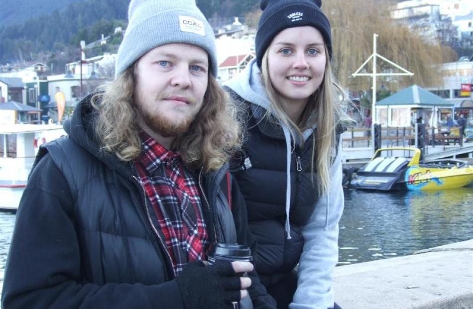 New Zealanders Brook Miller and Brittany Hart relax after arriving in Queenstown yesterday from...
