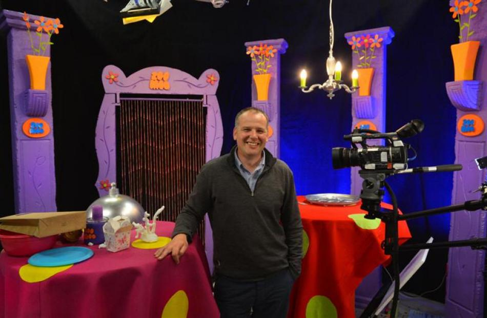 NHNZ managing director Kyle Murdoch, on one of the sets being used in a new television channel...