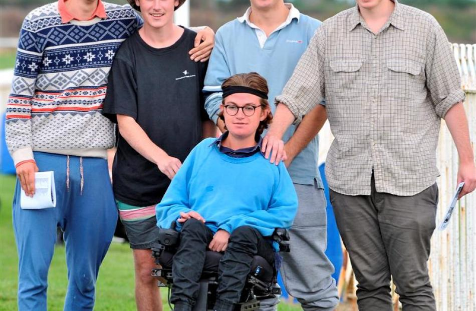 Nick Svensen (front) enjoys the dual code race day at Wingatui with friends (from left) Ben...