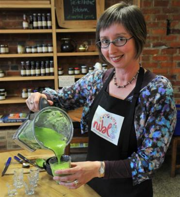Nicola Brown makes a green smoothie at Taste Nature on High Street. Photo by ODT.
