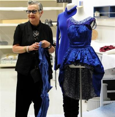 Nom*D founder and creative director Margi Robertson helps prepare an outfit which will soon be...