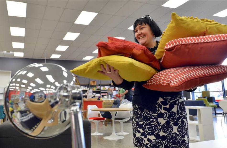 Nood staff member Elizabeth Marshall carries cushions for sale in a new Dunedin shop opening on...